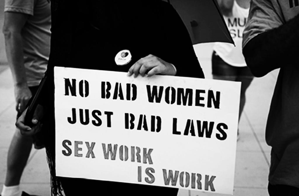 "Plakatas su užrašu ""No bad women, just bad laws. Sex work is work"""